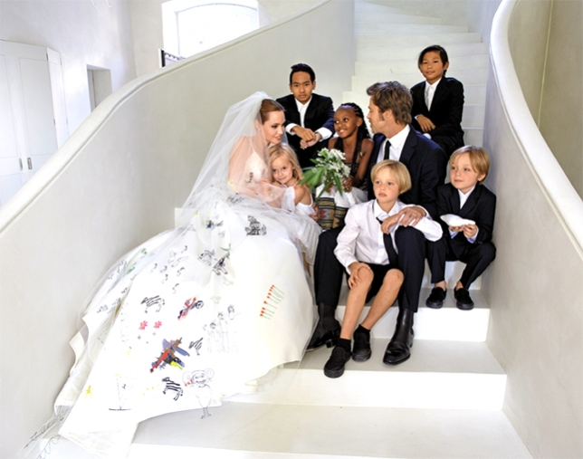 When Angelina married Brad, she had their children's artwork embroidered into her dress. Too colorful? Have children's artwork screen printed on a handkerchiefs for the bride, groom, and other special guests like grandparents. Sweet and sentimental.