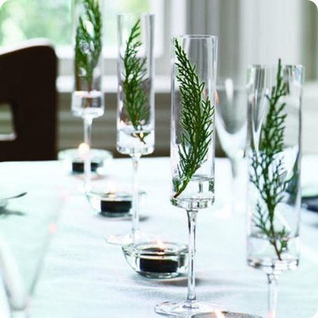Add a spring of something green (and not poisonous) to your stemware. This quick decoration adds some personality to the table and a new spin on cocktails. Try lavender or a small skewer of cranberries.
